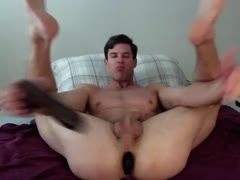 GT sucks a dildo with a ohmibod up his ass 2