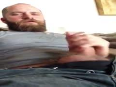 Flooding his beard with jizz