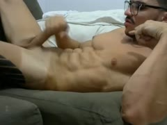 French muscled young guy jerks and cums over abs
