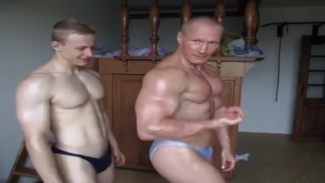 Muscle Dad/Lad worshipping each other